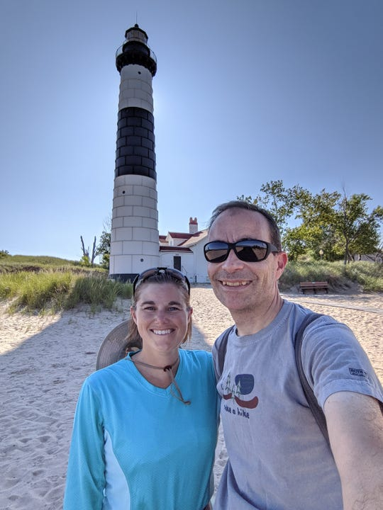 Jessi and Ari Adler of Okemos plan to visit all 103 Michigan state parks in 2019 to mark the system's centennial. Here they are at Big Sable Point Lighthouse in Ludington State Park Aug. 25, 2019.