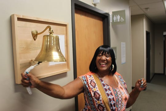 Cancer patients are invited to ring a gold bell after finishing their last day of treatment.