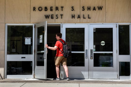 A student enters the front door of West Shaw Hall on Thursday, August 29, 2019, on the Michigan State Campus in East Lansing.