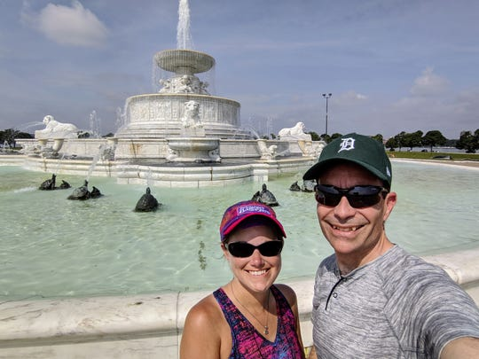 Jessi and Ari Adler by the James Scott Fountain at Belle Isle State Park July 6, 2019. The Okemos couple plan to visit all 103 state parks in Michigan in 2019.