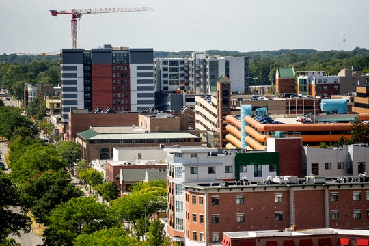 A view of downtown East Lansing from the rooftop of the Hub on Campus student apartment building on Thursday, Aug. 29, 2019, in East Lansing.