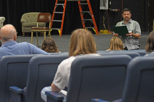 Connect director Drew Traxler talks to actors before they audition Wednesday evening.