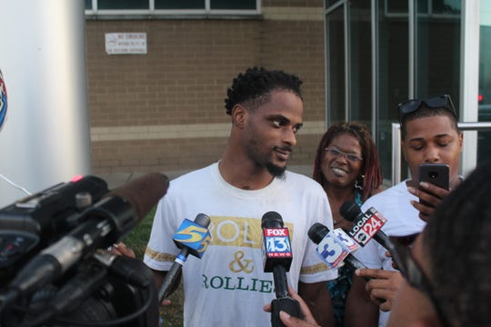 Martavious Banks speaks during a press conference with his family after he was released from jail following a 2018 officer-involved shooting. (Aug. 28, 2019)