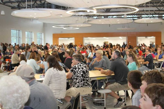 More than 1,200 people attended the dedication ceremony and ribbon-cutting for the new Silver Spring Intermediate School.