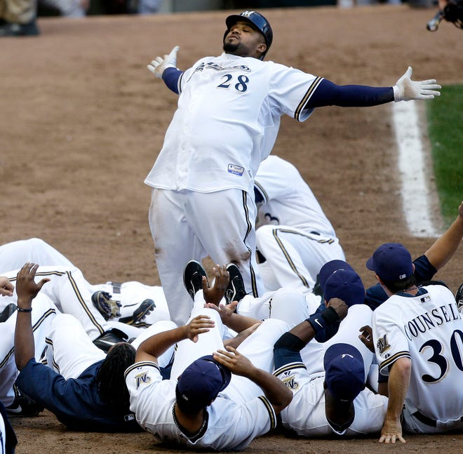 Milwaukee Brewers' Prince Fielder (28) reacts at home with teammates after hitting a walk-off home run during the 12th inning of a baseball game against the San Francisco Giants Sunday, Sept. 6, 2009, in Milwaukee. The Brewers won 2-1