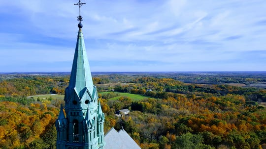 Fall colors surround the Basilica and National Shrine of Mary Help of Christians at Holy Hill on Oct. 19, 2017.