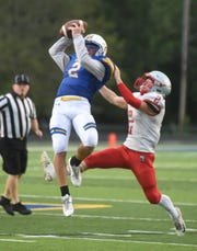 Mountain Home's Bryce McKay makes a leaping catch on a pass during scrimmage action against Highland last week.