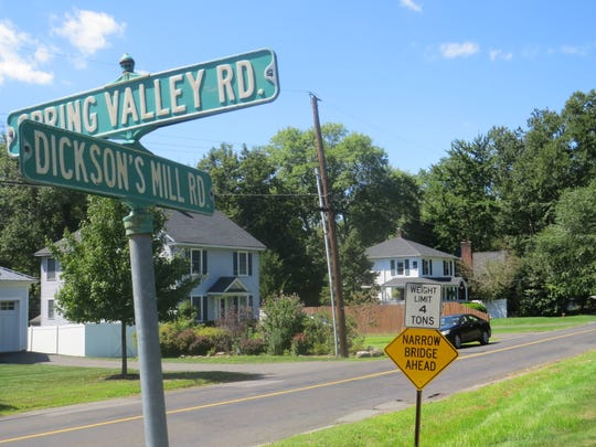 Harding residents and officials are up in arms over plans to replace this small bridge over Dickson's Mill Road with a 26-foot-wide span, 45 percent wider than the 18-foot backroad it connects.