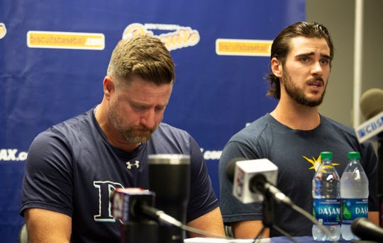 Montgomery Biscuits manager Morgan Ensberg fights back tears as Ryan Thompson, a pitcher with the team, talks about teammate Blake Bivens and the news that Bivens' wife and child were killed in Virginia.