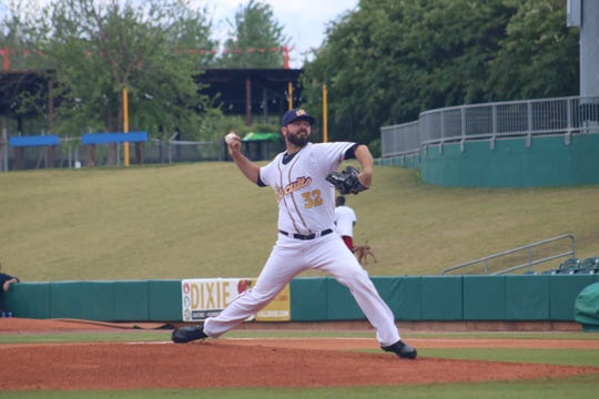 Blake Bivens pitches for the Montgomery Biscuits, a minor league affiliate of the Tampa Bay Rays.
