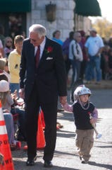 Troy Chancellor Jack Hawkins with grandson in tow getting ready for the Troy University Homecoming Parade through Downtown Troy Saturday morning, Nov. 13, 2010.