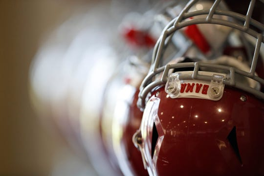 A row of helmets hang prior to an Alabama practice on Aug. 28, 2019 from inside the team's Mal Moore Athletic Complex in Tuscaloosa, Ala. (Photo by Robert Sutton/Alabama athletics)