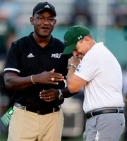 Alabama State head coach Donald Hill-Eley, left, and University of Alabama Birmingham head coach Bill Clark share a laugh before their game at Legion Field in Birmingham, Ala., on Thursday August 29, 2019.