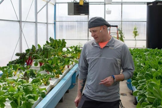 Joey Sarver manages the Teen Challenge ECSIA greenhouse in Elkhart.