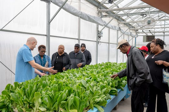 Members of a Gary church visits the Teen Challenge ECSIA greenhouse in Elkhart.