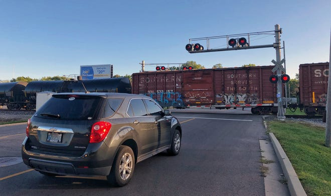 A Norfolk Southern train stops at the White River Blv. crossing in Muncie on Thursday morning. Motorists stopped there reported the train blocked the intersection 45 min to an hour.