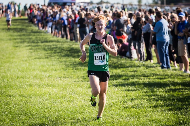 FILE -- Yorktown's Matthew Mitsch competes during the boys and girls cross country meet at Pendleton Heights High School Wednesday, Aug. 28, 2019.