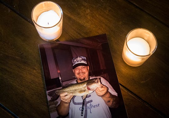 A picture of Rodney Tackett,  who died of an overdose earlier this year, sits on Erica Tackett's kitchen table.