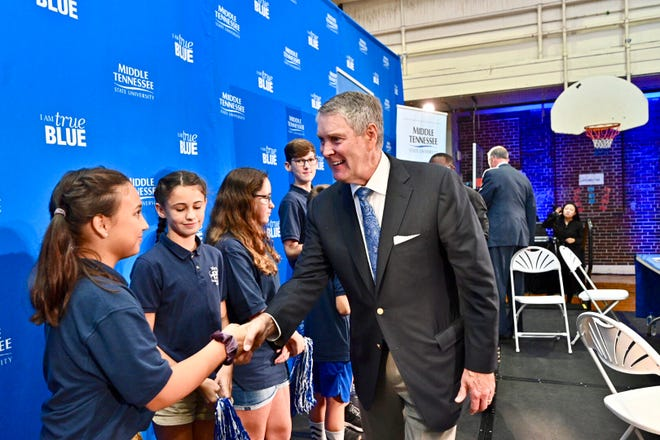 Former U.S. Sen. Bill Frist, founder and chariman of Tennessee's State Collaborative on Reforming Education, shakes hands with a Homer Pittard Campus School student after Wednesday's announcement that MTSU and SCORE will partner on a new initiative to ensure future teachers are better equipped for life in the classroom once they graduate MTSU.