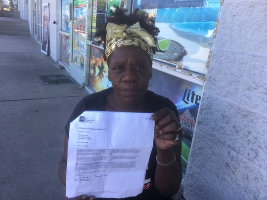 Tina Harris holds a letter from the Tennessee State Fire Marshal's Office that explains why residents at La Vergne's Oasis Hotel in must vacate the property. Harris said the room she and her husband rent has leaks in the bathroom.
