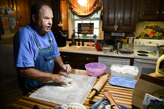 Country cook Hoyt Tidwell has amassed millions of views of his instructional videos for making chicken and dumplings and other home-cooked meals at his home Tuesday, Aug. 27, 2019 in West Point, Tenn.