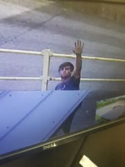 Springfield Police are looking for the man who waved at a security camera while he was stealing from a local business.