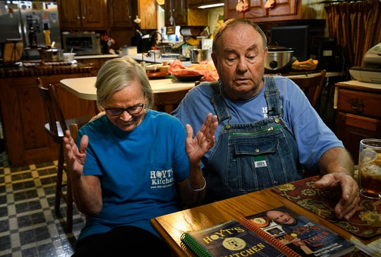 Suzy Tidwell laughs with her husband Hoyt Tidwell as he tells a story. Tidwell has amassed millions of views of his instructional videos for making chicken and dumplings and other home-cooked meals at his home Tuesday, Aug. 27, 2019 in West Point, Tenn.