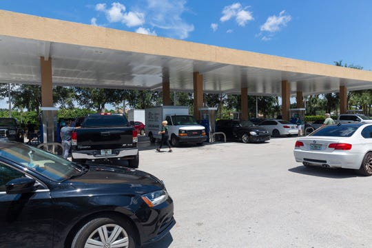 People line up at the Mobil gas station on Immokalee Road near Goodlette-Frank Road on Thursday, Aug. 29, 2019, in North Naples.