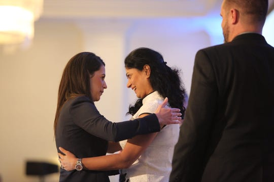 Reema Bhatia, owner of Stickboy Creative, hugs Bonita Springs Chamber President Tiffany Esposito during the annual luncheon Thursday.
