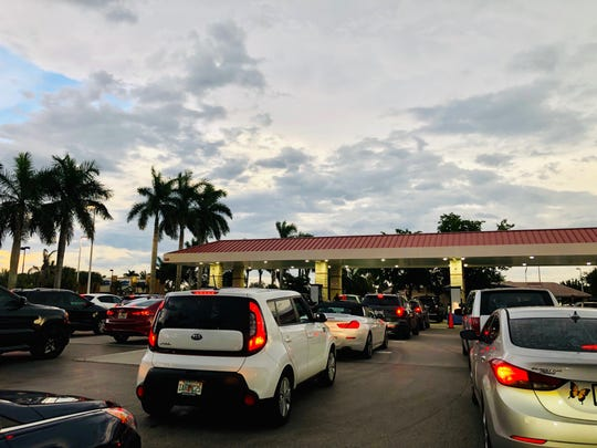 Cars line up at the Costco in Naples to get gas ahead of Hurricane Dorian's projected landfall.