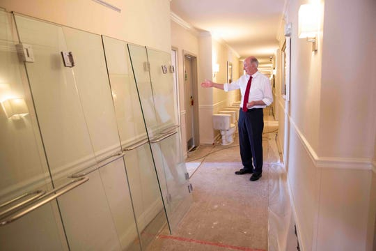 Owner Phil McCabe walks through a third-floor hallway where renovations are underway at The Inn on Fifth in Naples on Tuesday, August 27, 2019.
