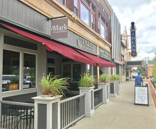 The Mark on the Square, which shares space with River Road Coffeehouse, recently celebrated its grand opening on North Park Place.