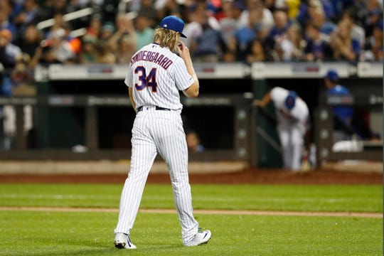 New York Mets starting pitcher Noah Syndergaard walks toward the dugout after allowing six runs during the first inning of the team's baseball game against the Chicago Cubs, Wednesday, Aug. 28, 2019, in New York. Syndergaard allowed 10 runs and three homer runs in three innings. (AP Photo/Kathy Willens)