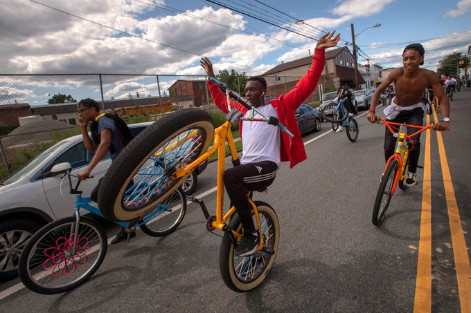 "Bike riders in the ""North Jersey Summer Rideout,"" which started in Clifton, ride through Passaic on Saturday, August 24, 2019."
