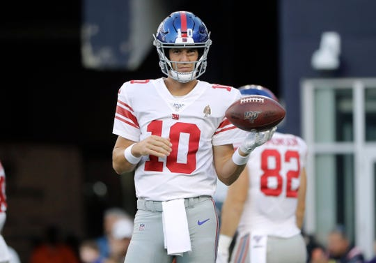 New York Giants quarterback Eli Manning warms up before an NFL preseason football game against the New England Patriots, Thursday, Aug. 29, 2019, in Foxborough, Mass. (AP Photo/Steven Senne)