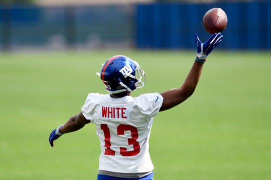 New York Giants rookie wide receiver Reggie White, Jr. makes a one-handed catch during Giants OTA's on Monday, May 19, 2019, in East Rutherford.