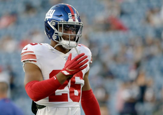 New York Giants running back Saquon Barkley warms up before an NFL preseason football game against the New England Patriots, Thursday, Aug. 29, 2019, in Foxborough, Mass. (AP Photo/Steven Senne)