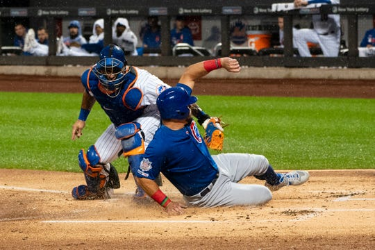 Aug 28, 2019; New York City, NY, USA; Chicago Cubs left fielder Kyle Schwarber (12) slides under the tag by New York Mets catcher Wilson Ramos (40) and scores a run during the first inning at Citi Field. Mandatory Credit: Gregory J. Fisher-USA TODAY Sports