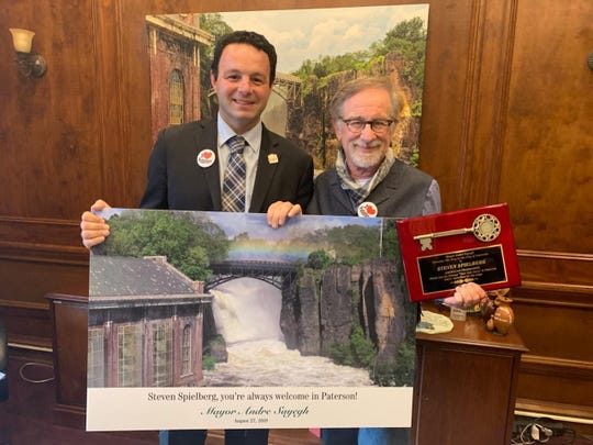 Paterson Mayor Andre Sayegh presents Steven Spielberg with a key to the city Aug. 27, 2019.