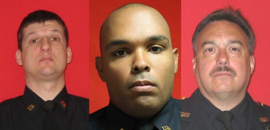 From left, Port Authority Officer George Kwiecinski, Officer Miguel Correa-Rodriguez and Sgt. Michael Barry