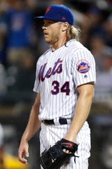 New York Mets starting pitcher Noah Syndergaard reacts during the first inning of the team's baseball game against the Chicago Cubs, Wednesday, Aug. 28, 2019, in New York. Syndergaard allowed 10 runs and three homers in three innings. (AP Photo/Kathy Willens)