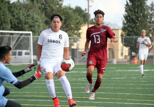 Sophomore Wildcat Aaron Nava (13) looked for an opening against Chaparral.
