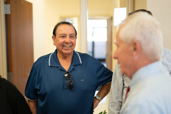 """City of Deming Councilman Joe """"Butter"""" Milo visits with Mimbres Memorial Hospital personnel during an open house and ribbon cutting ceremony for the new outpatient rehabilitation center in the Mimbres Professional Building at 905 S. Eighth St. in Deming, NM."""