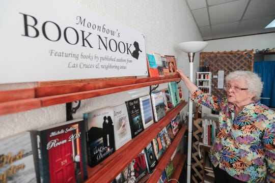 Alice Davenport shows off her Book Nook full of local artists at her Moonbow Alteration, Sewing and Gift Shop in Las Cruces on Thursday, Aug. 29, 2019.