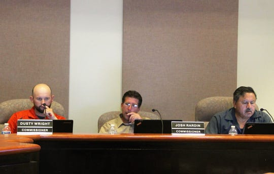 Alamogordo City Commissioners Dusty Wright, Josh Rardin and Al Hernandez at the commission's regular meeting Aug. 27.