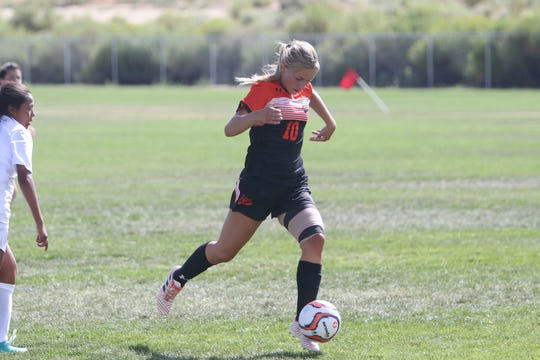 Aztec's Autumn Roundy, seen here playing against Piedra Vista during the Aztec Tiger Shootout tournament on Saturday, Aug. 24, is the Daily Times Athlete of the Month.