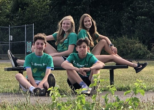 Former Bird Elementary students (clockwise from far left) Donovan Murphy, Libby Phillips, Isabell Kulick and Wesley Hart) completed a multi-year project that resulted in the building of an exercise path behind their former school.