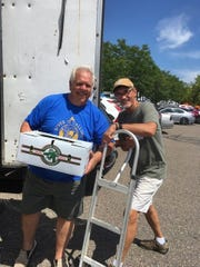 Market Manager Walt Gajewski helps CARES Director Todd Lipa load boxes bound for CARES new walk-in coolers at the Farmington Hills outreach center and pantry (the former St. Alexander church in Farmington Hills).