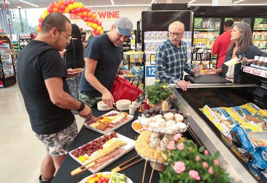 Friends and family attend a soft opening of the Grocery Outlet Bargain Market store in downtown Palm Springs on Aug. 28, 2019.