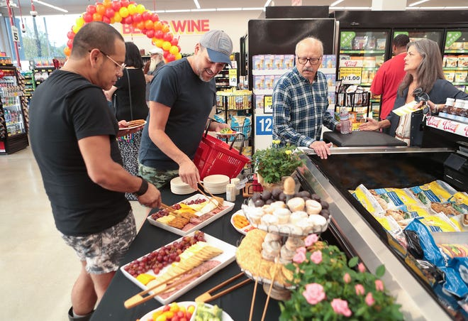 Friends and family attend a soft opening of the Grocery Outlet store in downtown Palm Springs on Aug. 28, 2019. La Quinta city officials confirmed on Thursday that Grocery Outlet will be opening in half of the long-vacant store once occupied by Ralphs in the La Quinta Village shopping center.